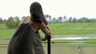 Couple standing on the terrace and listening music, close up, steadycam shot