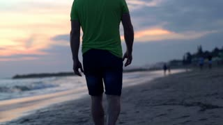 Couple walking on the beach during sunset, steadycam shot, slow motion shot at 2