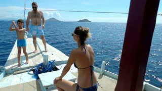 Family spending their time on the boat during vacations, slow motion shot at 240