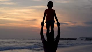 Father gives his son a piggyback, steadycam shot, slow motion shot at 240fps