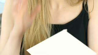 Girl crying while reading very sad letter, steadycam shot