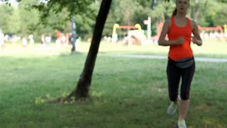 Girl stops running in the park because of the headache, steadycam shot