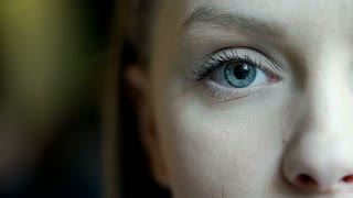 Girl with beautiful, blue eye looking to the camera