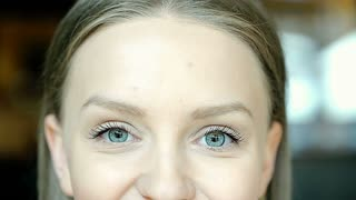 Girl with beautiful blue eyes smiling to the camera, steadycam shot