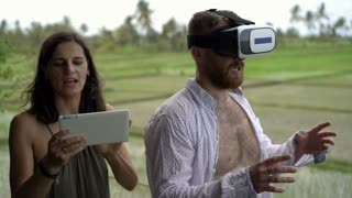 Happy couple standing outside and man wearing goggles 3d, steadycam shot