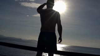Man admires the sea and feels relaxed, steadycam shot, slow motion shot at 240fp