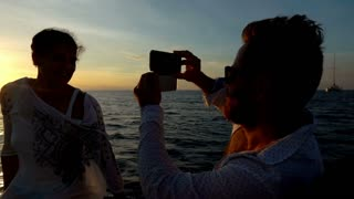 Man doing photos of his girlfriend while sunsetting, slow motion shot at 240fps,