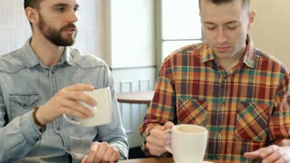 Man saying goodbye and leaving friend in the cafe, steadycam shot