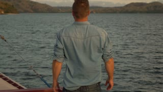 Man standing back on the boat and feels free, slow motion shot at 240fps, steady