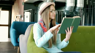 Pretty girl in bowler hat finish reading book because of painful headache