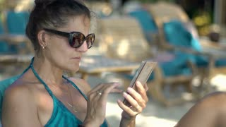 Woman browsing internet on smartphone and looks shocked after having receives ba