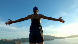 Woman standing on the mountain and feels free, slow motion shot at 240fps, stead