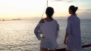 Women admires the view and looking on boats, steadycam shot, slow motion shot at 240fps