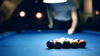 View of billiard's table and man playing snooker