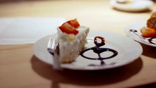 View of delicious cake lying on the plate in the cafe, steadycam shot
