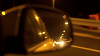 View of highway and cars in the back mirror, steadycam shot