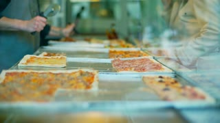 View of slices of pizza in the restaurant, steadycam shot