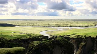 View of the magnificent Fjadrargljufur canyon and a river running inside in sout