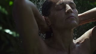 Woman bathing in the garden, slow motion shot at 240fps