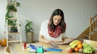 Woman calculate something on smartphone and being succesful