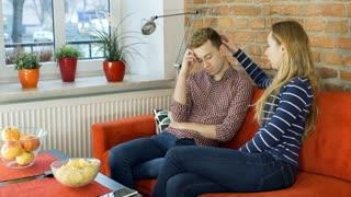 Woman comforts her sad boyfriend and speaks to him, steadycam shot