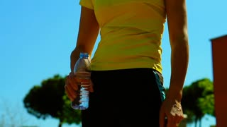 Woman drinking water during her break, steadycam shot, slow motion shot at 240fp