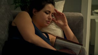 Woman fall asleep druing reading book in the evening