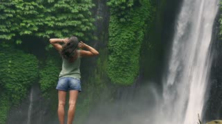 Woman feeling free and touching her hair, slow motion shot at 240fps