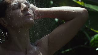 Woman having a shower in the garden, slow motion shot at 240fps
