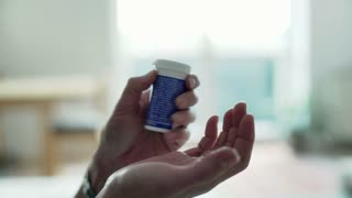 Woman holding medicaments on her hands and touching them