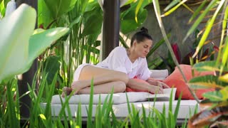 Woman reading book in exotic place
