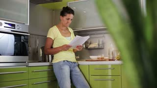 Woman reading the letter with bad news