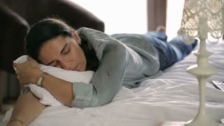 Woman resting while sleeping in the bed