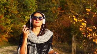 Woman running and listening music on headphones, steadycam shot, slow motion sho