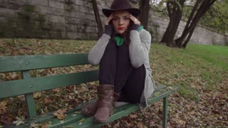 Woman sitting on the bench with headache, slow motion shot at 240fps