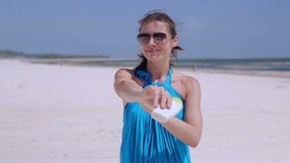 Woman spread sun cream on her arms