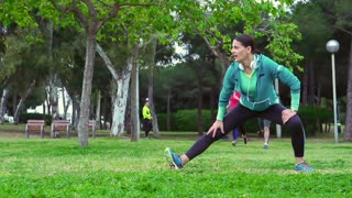 Woman stretching muscles before running, steadycam shot, slow motion shot