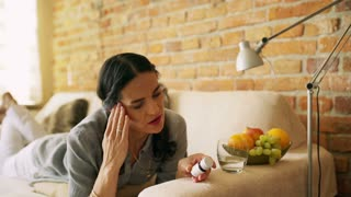 Woman taking pills beacuse of headache