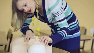 Woman teaching how to prepare to give first aid, steadycam shot