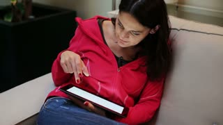 Woman using tablet on the sofa