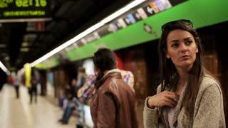 Woman waiting for subway, steadycam shot.