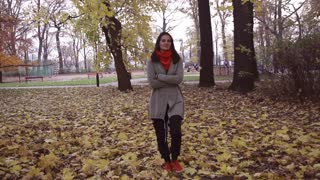 Woman walking in the park and relaxing, steadycam shot, slow motion  240fps