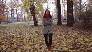 Woman walking in the park and relaxing, steadycam shot, slow motion shot
