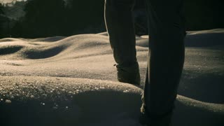 Woman walking on deep snow and cave, steadycam shot, slow motion shot at 240fps