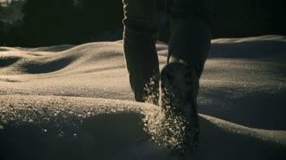 Woman walking on deep snow and cave, steadycam shot, slow motion shot