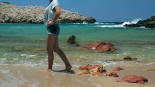 Woman walking on the sandy beach and relaxing