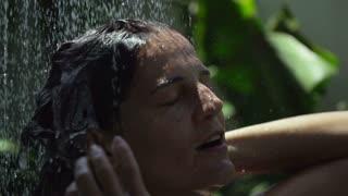 Woman washing hair with shampoo, slow motion shot at 240fps