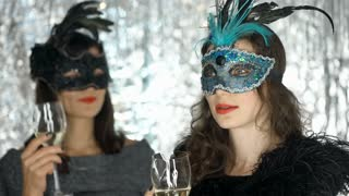 Women meeting at the masquerade party and chatting with each other, steadycam sh