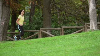 Women running on grass in the park, slow motion shot at 240fps, steadycam shot