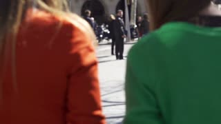 Women walking with shopping bags on the street, slow motion shot at 120fps